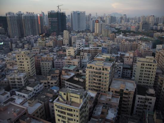 randy-olson-modern-architecture-surrounds-older-buildings-in-shenzhen