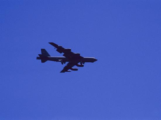 raul-touzon-a-military-jet-speeds-through-a-clear-blue-sky