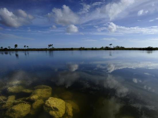 raul-touzon-cloud-reflections-in-still-water-in-everglades-national-park