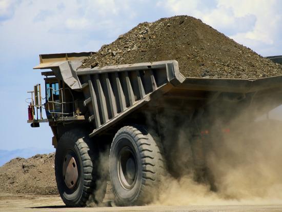 raymond-gehman-a-dump-truck-carrying-gravel-kicks-up-a-cloud-of-dust