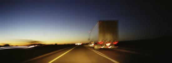 rear-view-of-truck-on-a-two-lane-highway-las-cruces-new-mexico-usa
