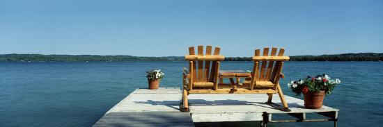 rear-view-of-two-adirondack-chairs-on-a-dock-minnesota-usa