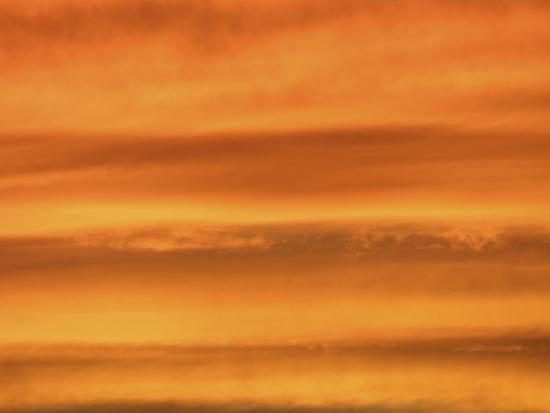 red-fluffy-clouds-at-sunset