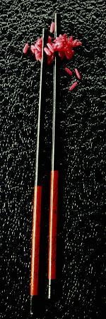 red-rice-with-chopsticks-on-black-background