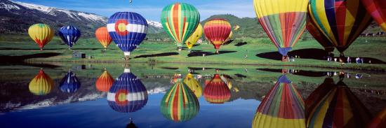 reflection-of-hot-air-balloons-on-water-colorado-usa