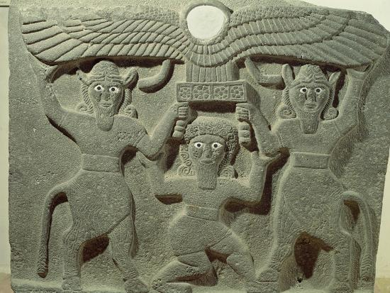 relief-depicting-gilgamesh-between-two-bull-men-supporting-a-winged-sun-disk-fr-tell-halaf-syria
