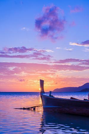 remy-musser-beautiful-sunrise-in-rawai-phuket-island-thailand-with-long-tailed-boat-ruea-hang-yao