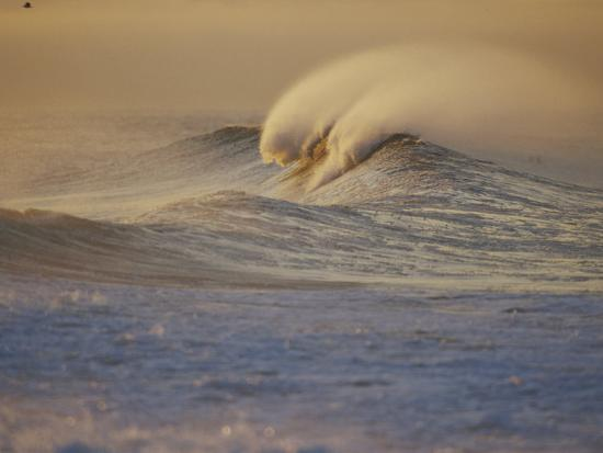 rich-reid-sunlight-reflects-off-surf-at-sunrise