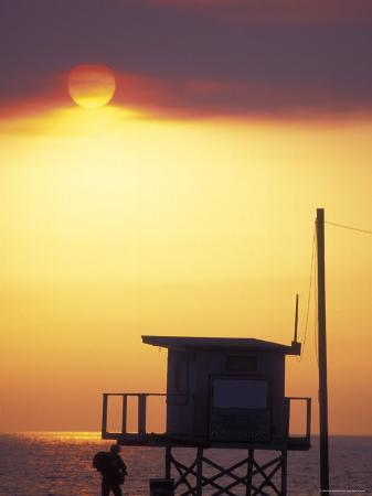 rich-reid-sunset-during-the-malibu-fires-silhouette-of-lifeguard-stand-california