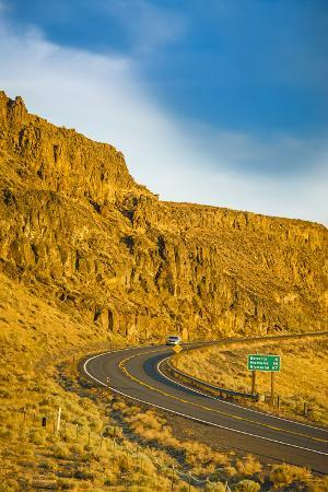 richard-duval-washington-vantage-car-on-road-through-columbia-river-basalt-group