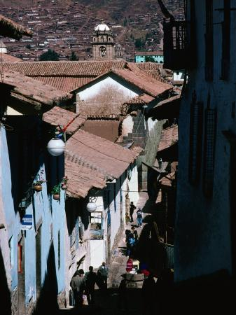 richard-i-anson-steep-and-narrow-hatunrumiyoc-street-with-la-merced-tower-in-distance-cuzco-peru