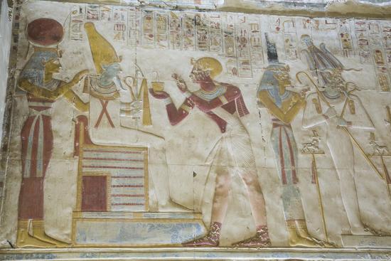 richard-maschmeyer-pharaoh-seti-i-in-center-making-an-offering-to-the-seated-god-osiris