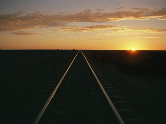 richard-nowitz-a-view-at-sunrise-of-the-indian-pacific-railroad-crossing-the-nullarbor-plain