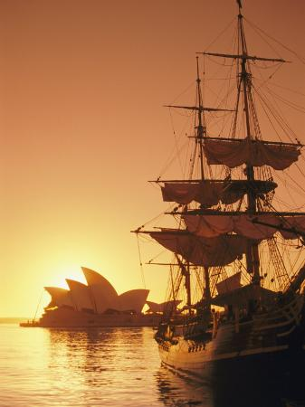 richard-nowitz-sydney-opera-house-and-the-hms-bounty-a-replica-of-the-famous-ship-silhouetted-by-the-setting-sun