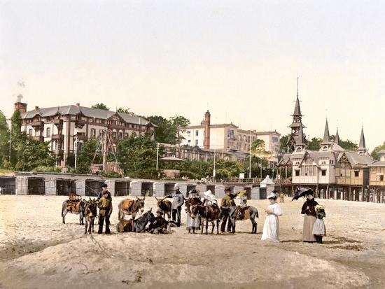 riding-donkeys-on-the-beach-at-heringsdorf-germany-pub-c-1895