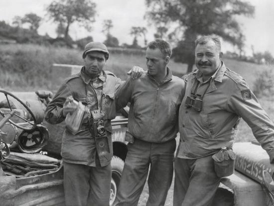 robert-capa-left-and-ernest-hemingway-right-with-their-driver-u-s-army-driver