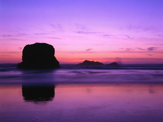 robert-glusic-rock-silhouetted-at-twilight