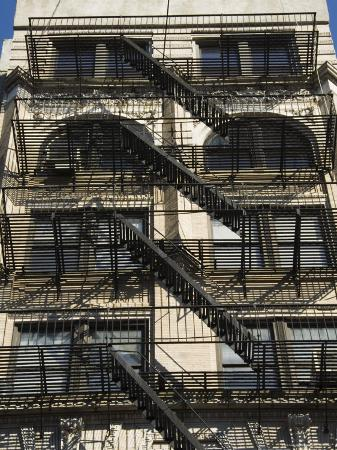 robert-harding-fire-escapes-on-the-outside-of-buildings-in-spring-street-soho-manhattan-new-york-usa