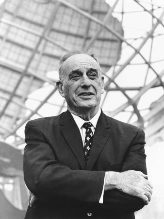 robert-moses-in-front-of-the-new-york-s-world-fair-signature-structure-the-unisphere