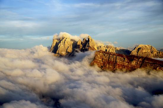 roberto-moiola-aerial-shot-from-seceda-of-odle-surrounded-by-clouds-at-sunset-in-the-dolomites
