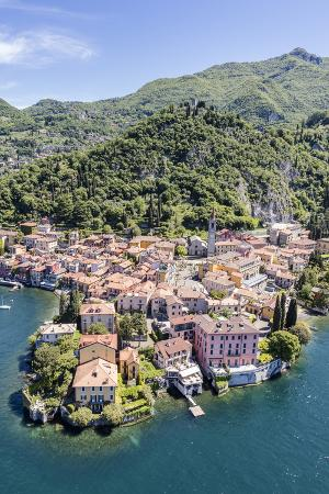 roberto-moiola-aerial-view-of-the-picturesque-village-of-varenna-surrounded-by-lake-como-and-gardens