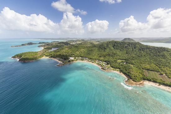 roberto-moiola-aerial-view-of-the-rugged-coast-of-antigua-full-of-bays-and-beaches-fringed-by-tropical-vegetation