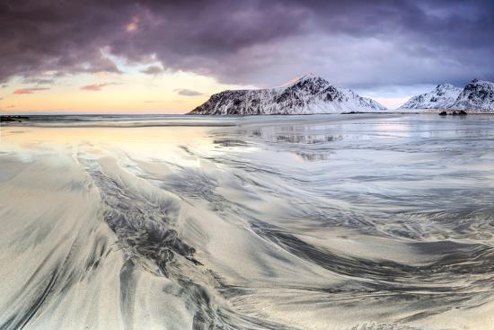 roberto-moiola-sunset-on-the-surreal-skagsanden-beach-surrounded-by-snow-covered-mountains