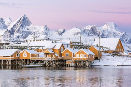 roberto-moiola-the-colors-of-dawn-frame-the-fishermen-s-houses-surrounded-by-frozen-sea-sakrisoy-reine