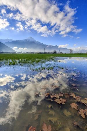 roberto-moiola-the-natural-reserve-of-pian-di-spagna-flooded-with-mount-legnone-reflected-in-the-water-italy