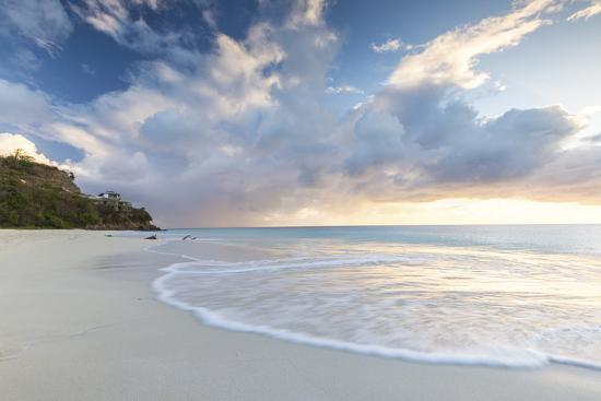 roberto-moiola-the-sky-turns-pink-at-sunset-and-reflected-on-ffryes-beach-antigua-antigua-and-barbuda