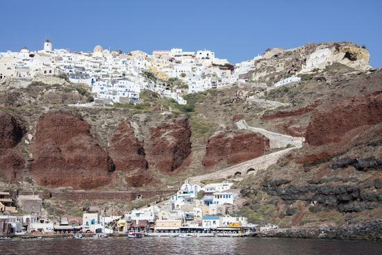 roberto-moiola-typical-greek-village-perched-on-volcanic-rock-with-white-and-blue-houses-and-windmills-santorini