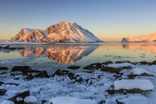roberto-moiola-view-of-the-mountains-of-gymsoya-gimsoya-from-smorten-reflected-in-the-clear-partially-frozen-sea