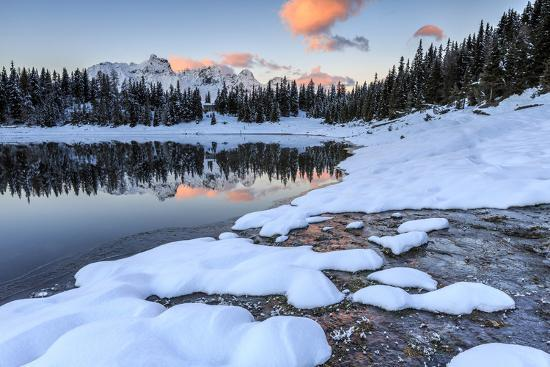 roberto-moiola-woods-and-snowy-peaks-are-reflected-in-lake-palu-at-sunrise-malenco-valley-valtellina-italy