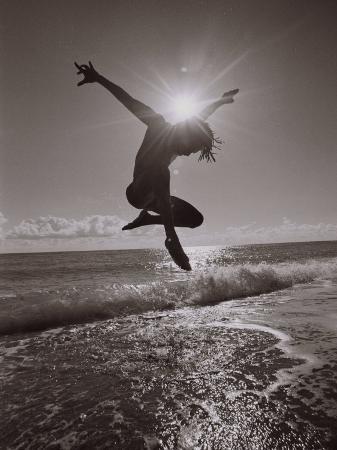robin-hill-silhouette-of-dancer-jumping-over-atlantic-ocean