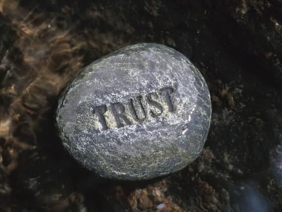 rock-with-the-word-trust-in-water