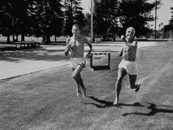 runner-herb-elliot-running-with-his-trainer-percy-cerutty