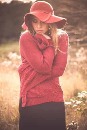 sabine-rosch-young-woman-outdoors-wearing-a-red-hat
