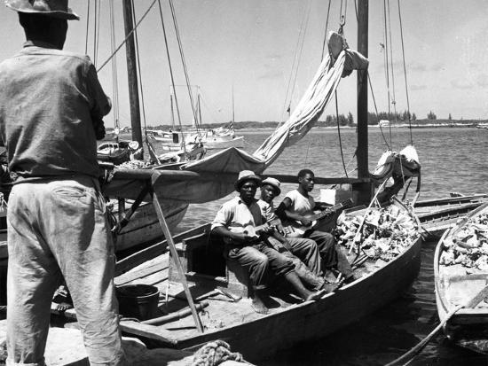 sailboat-docked-at-nassau-bahamas-c-1950