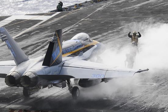 sailors-prepare-an-f-a-18c-hornet-to-launch-from-uss-nimitz