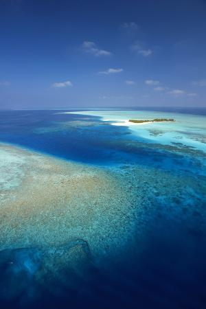 sakis-papadopoulos-aerial-view-of-tropical-island-and-lagoon-maldives-indian-ocean-asia