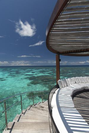 sakis-papadopoulos-stairs-to-the-beach-and-sofa-overlooking-the-ocean-maldives-indian-ocean