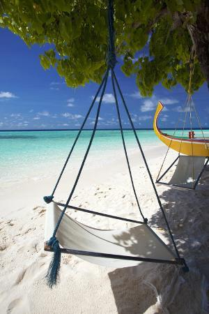 sakis-papadopoulos-swing-and-traditional-boat-on-tropical-beach-maldives-indian-ocean-asia