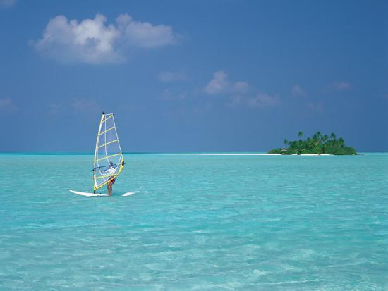 sakis-papadopoulos-young-man-windsurfing-near-tropical-island-and-lagoon-in-the-maldives-indian-ocean