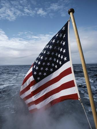 sam-abell-an-american-flag-flutters-from-the-back-of-a-boat-in-neah-bay