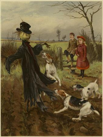 scarecrow-being-attacked-by-a-pack-of-dogs-as-a-boy-and-girl-watch