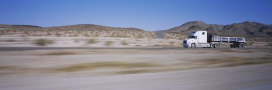 semi-truck-on-a-highway-blurred-motion