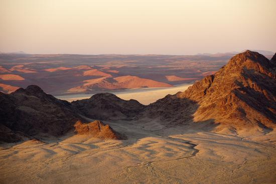 sergio-pitamitz-light-illuminates-the-naukluft-mountains-and-namib-desert-at-sunrise