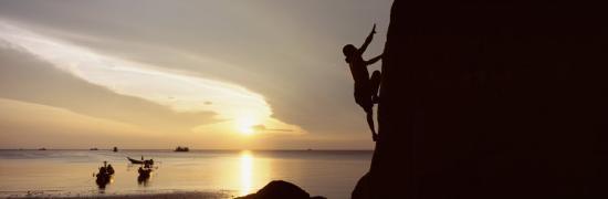 silhouette-of-a-man-climbing-a-rock-railay-beach-krabi-thailand