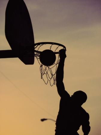 silhouette-of-a-man-slam-dunking-a-basketball