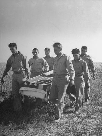 six-men-of-us-squadron-carry-the-flag-draped-coffin-of-a-member-of-their-outfit